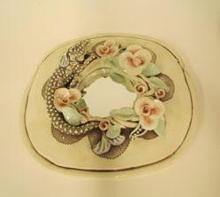 Mirror with lizard and flowers